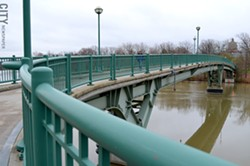 The pedestrian bridge links Brooks Landing in the 19th Ward to the University of Rochester River - Campus. - FILE PHOTO