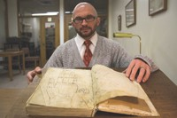 The Sibley Library's Peter Coppen --- and a thousand-year-old illustration. - PHOTO BY JOE BELL