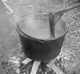 PHOTO BY ADAM WILCOX - The well-tempered turn and constant stir: the kettle that cooked the apple butter in Hilton.