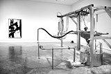 "COURTESY OF ALBRIGHT-KNOX ART GALLERY - There's no - artist here but this machine: Roxy Paine's ""Painting Manufacture Unit."" A - painting by Franz Kline is in the background."