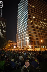 MATT DETURCK - Thousands flocked to Manhattan Square Park for the Bandaloop performance during Fringe 2012.