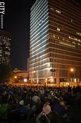 MATT DETURCK - Thousands flocked to Manhattan Square Park for the Bandaloop performance during Fringe 2012.