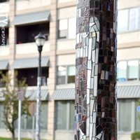Art Walk Extension Tile mosaics on streetlight poles created by local students. PHOTO BY MATT DETURCK