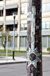 Tile mosaics on streetlight poles created by local students.