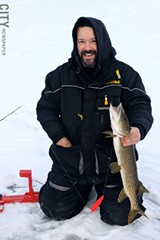 Tim Thomas with his catch. - PHOTO BY KATHY LALUK