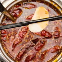 """Yummy Garden Hot Pot ... to fiery """"spicy"""" broths, filled with chili oil, garlic Szechuan peppercorns, and spices. PHOTO BY MARK CHAMBERLIN"""