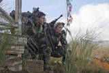 """Tom Cruise and Emily Blunt in """"Edge of Tomorrow."""" - PHOTO COURTESY WARNER BROS. PICTURES"""