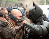 "Tom Hardy as Bane and Christian Bale as Batman in ""The Dark Knight Rises."" PHOTO COURTESY WARNER BROS. PICTURES"