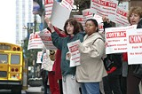 PHOTO BY KRESTIA DEGEORGE - Tragedy waiting to happen: Members of the Federation of Social Workers protest the county budget proposal, among other things, last week in downtown Rochester.