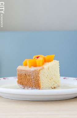 Tres Leches cake topped with cantaloupe from La Marifinga. - PHOTO BY MARK CHAMBERLIN