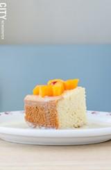 Tres Leches cake topped with cantaloupe from La Marifinga. - PHOTO BY MARK CHAMBERLIN