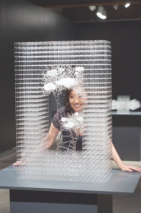 Eunsuh Choi with one of her intricate glass sculptures. - PHOTO PROVIDED