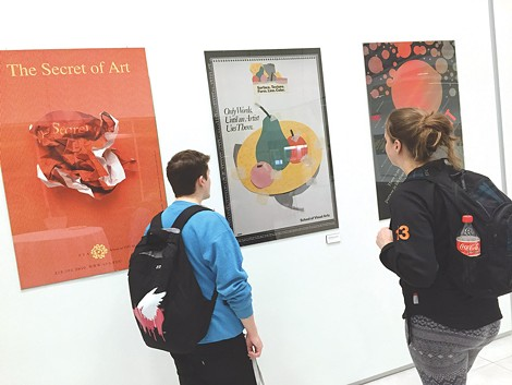 Students check out the Milton Glaser poster show currently on view at RIT's University Gallery. - PHOTO COURTESY SUE WEISLER/RIT UNIVERSITY NEWS SERVICES
