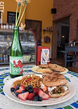 The chickpea and eggplant patty with sesame noodles and fruit salad. Lemon, chocolate macadamia nut, and oatmeal raisin cookies complete the meal. - PHOTO BY RENÉE HEININGER