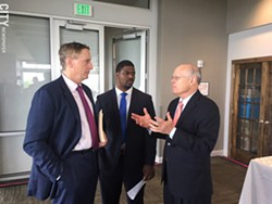 Greater Rochester Chamber of Commerce CEO Bob Duffy, left, and Adrian Hale, the Chamber's workforce and economic development manager, talk with charter school advocate David Osborne during a break at a conference Thursday. - PHOTO BY TIM LOUIS MACALUSO