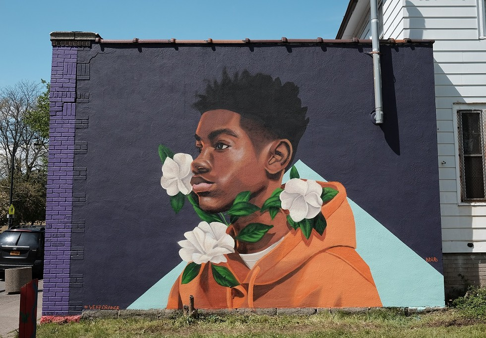"""Brittany Williams' mural """"Through Tragedy, There's Hope"""" on the side of Rocky's Pizza on Genesee Street. The piece was a collaboration between Wall\Therapy and Moms Demand Action, a national grassroots organization that pushes for public safety measures. - PHOTO BY JASON WILDER"""