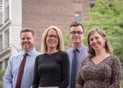 Dorraine Kirkmire, the city's manager of planning (second from the left in the photo), says the city's comprehensive plan has to strike a balance between being visionary and being realistic. In the photo, from the left, are Associate City Planner Kevin Kelley, Kirkmire, City Planner Scott Thompson, and Senior Community Planner Elizabeth Murphy. - PHOTO BY RYAN WILLIAMSON