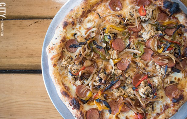 There's a menu of wood-fired, 12-inch pizzas, most of which include spiedies as toppings, though anything on the menu is available in a vegetarian version. Pictured: the Plain Jane pizza. - PHOTO BY JACOB WALSH
