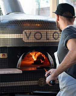 VOLO's brick, wood-fired Acunto Napoli oven is capable of flash-baking a pizza in just 60 seconds. - PHOTO BY JACOB WALSH