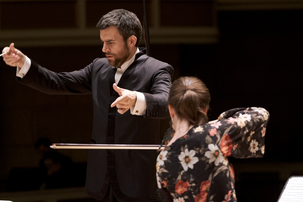 "RPO Music Director Ward Stare and violinist Tessa Lark in dress rehearsal for  ""Bach to Bartók."" - PHOTO BY ERICH CAMPING"