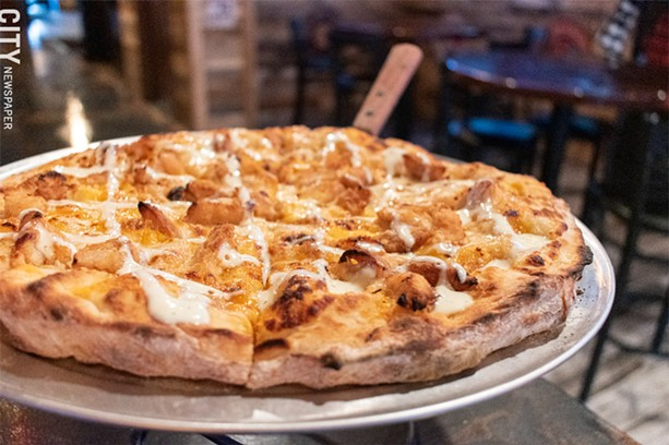 The Country Sweet pizza features the titular sauce for a base, chopped chicken tenders, and cheddar. - PHOTO BY JACOB WALSH