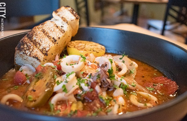 Not your usual flash-fried squid: the Calamari di Roma is sautéed with cherry peppers, onions, garlic, and tomato sauce. - PHOTO BY JACOB WALSH