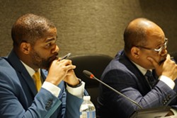 Superintendent Terry Dade and school board President Van White listen to speakers during a board meeting. - FILE PHOTO