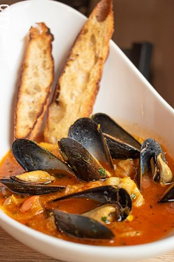 At The Peppered Pig, the bouillabaisse -- a Provençal seafood stew of various fish, shellfish, fennel, saffron, and tomatoes -- contains scallops, mussels, and grouper. - PHOTO BY JACOB WALSH