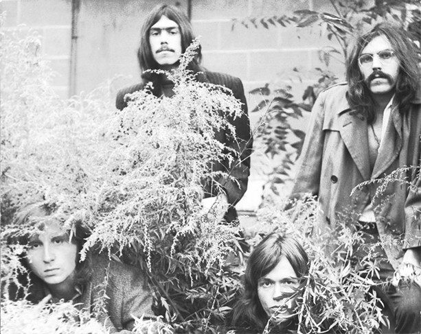 The early-70s Rochester blues rock band Rain (left to right): bassist Ted Paris, drummer MIck Guerin, singer Brad Morse, and guitarist Helmut Getto. - PHOTO BY JOE PELLINGRA
