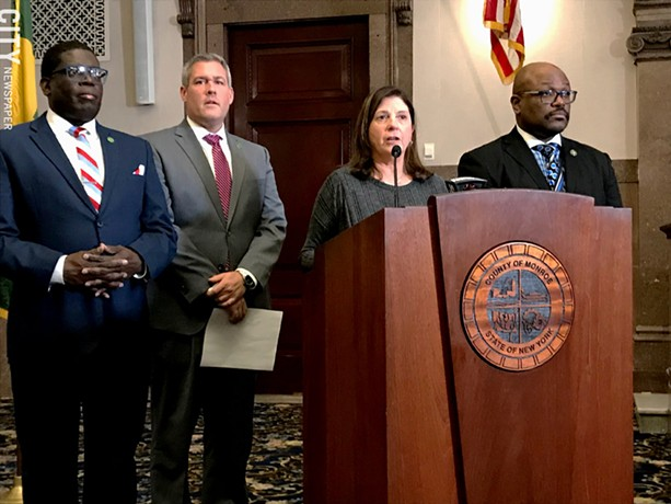 """Republican Monroe County Legislator Karla Boyce, flanked by Democrats, explains her decision to vote to repeal the """"police annoyance"""" law she sponsored months ago. Pictured with her are Democratic Minority Leader Vincent Felder, County Executive Adam Bello, and Legislator Ernest Flagler-Mitchell. - FILE PHOTO"""