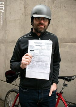 """Cyclist Bryan Agnello was sued by the driver of a car that struck him. The case is headed to """"The People's Court."""" - PHOTO BY RENÉE HEININGER"""