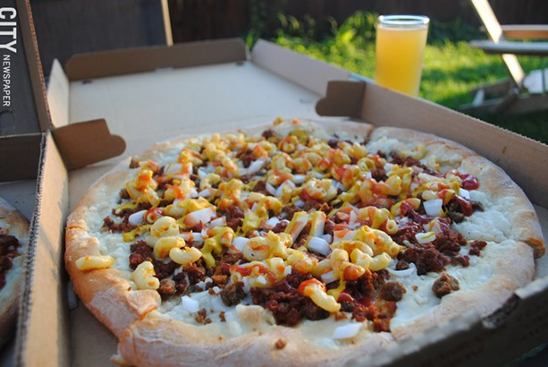 Vegan pizza and other meals are available for pick-up from New Ethic Vegan Pizza. - PHOTO BY RENÉE HEININGER