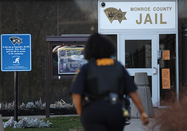 A Monroe County Sheriff's deputy outside the Monroe County Jail in downtown Rochester. - PHOTO BY MAX SCHULTE