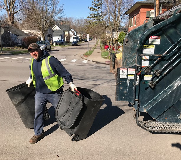 Todd Shuryn, of the Fairport Department of Public Works, makes the rounds in the village. - PHOTO BY DAVID ANDREATTA