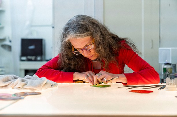 Stained-glass artist Judith Schaechter at work. - PHOTO PROVIDED