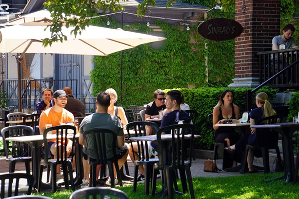 The scene outside Sinbad's Mediterranean Cuisine on June 4, 2020, the first day outdoor restaurant seating was re-introduced. - PHOTO BY GINO FANELLI