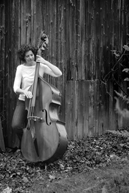 Despite her hearing loss, double bassist McCormick still teaches music and serves as Eastman Performing Arts Medicine's program manager. - PHOTO BY DANIEL FISCHER
