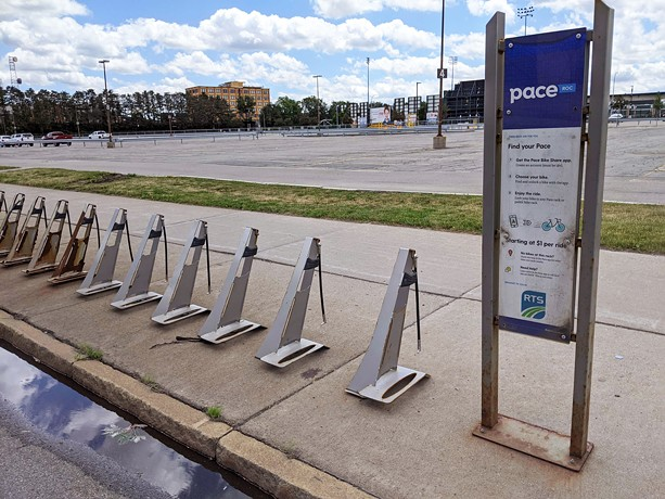 An empty Pace bike share rack remains near Monroe Community College's downtown campus on State Street. - PHOTO BY JEREMY MOULE
