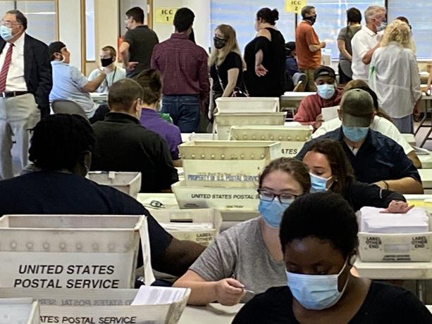 Monroe County Board of Elections workers count absentee ballots at the board's service center. - PHOTO BY JAMES BROWN, WXXI NEWS