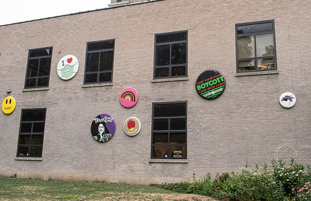 """A cluster of the """"button"""" designs for the recent public art installation, """"Underpin & Overcoat"""" on the side of Rochester Contemporary Art Center in the East End. - PHOTO BY JACOB WALSH"""