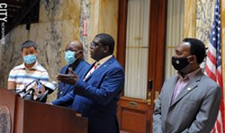 Vince Felder, Democratic minority leader of the County Legislature, defends elections commissioners LaShana Boose and Lisa Nicolay during a news conference following a troubled primary election day. Standing with him are, from left, county legislators Calvin Lee, Ernest Flagler-Mitchell, and Frank Keophetlasy. - PHOTO BY JEREMY MOULE