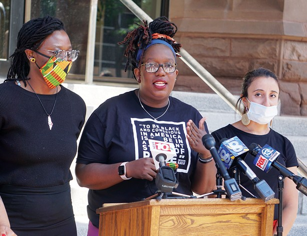 Free the People Roc's Stanley Martin, left, Ashley Gantt, center, and Iman Abid, right, called for the Rochester City Council to defund the Rochester Police Department during a news conference in June. - PHOTO BY GINO FANELLI