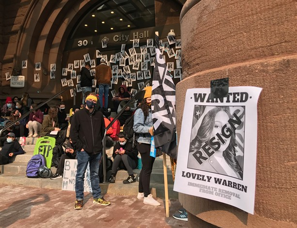 Protesters plastered City Hall in September 2020 with posters calling for Mayor Lovely Warren's resignation. - PHOTO BY DAVID ANDREATTA