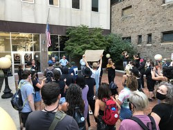 Protesters marched to the DA's office and called for Doorley's resignation. - CREDIT NOELLE E. C. EVANS | WXXI NEWS