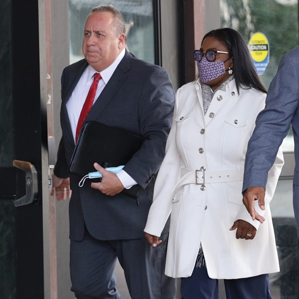 Defense attorney Joe Damelio accompanies his client, Mayor Lovely Warren, to court for her arraignment in October 2020. - PHOTO BY MAX SCHULTE