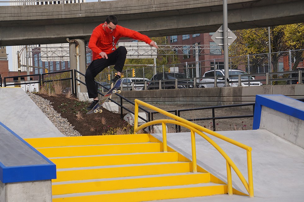 Nick Donofrio frontside 180s a stair set at the Roc City Skatepark. - PHOTO BY GINO FANELLI