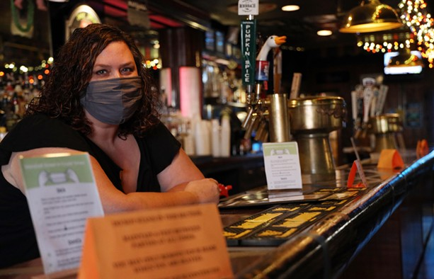 Kelly Bush, owner of the Marshall Street Bar and Grill, behind the bar. Bush is also president of the Rochester chapter of the New York State Restaurant Association. - PHOTO BY MAX SCHULTE
