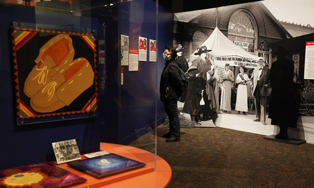 Jennifer Jess of Rochester looks at local icons of the suffrage movement. - PHOTO BY MAX SCHULTE