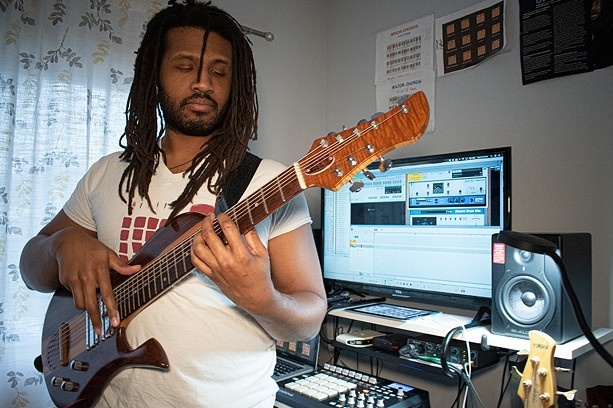 Phillip Coleman, a.k.a. GodClouD, at work in his home studio in Rochester. - PHOTO BY JACOB WALSH