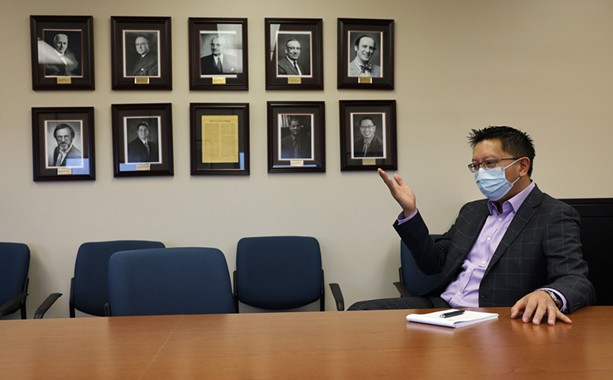 Monroe County Public Health Commissioner Dr. Michael Mendoza speaks from a conference room near his office at the county Health Department. - PHOTO BY MAX SCHULTE